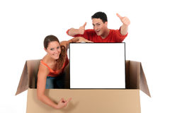 Chat box couple advertizing. Young couple friends in chat box, cardboard box representing chat room holding advertising board.  Studio, white background Stock Images