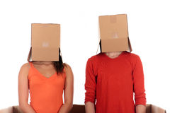 Chat box couple quarrel. Young couple having quarrel during chat session, chat box, cardboard box representing chat room.  Studio, white background Stock Photography