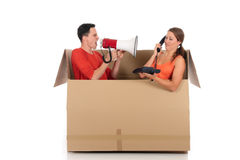 Chat box couple quarrel. Young couple having quarrel during chat session, chat box, cardboard box representing chat room.  Studio, white background Royalty Free Stock Image