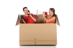 Chat box couple quarrel. Young couple having quarrel during chat session, chat box, cardboard box representing chat room.  Studio, white background Stock Images
