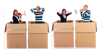 Chat box couple quarrel. Young couple having quarrel during chat session, chat box, cardboard box representing chat room.  Studio, white background Royalty Free Stock Photo