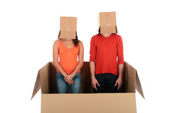 Chat box couple quarrel. Young couple having quarrel during chat session, chat box, cardboard box representing chat room.  Studio, white background Royalty Free Stock Photos