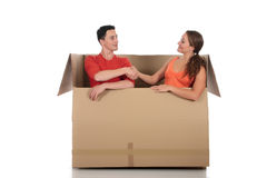 Chat box friends couple. Young couple friends in chat box, cardboard box representing chat room.  Studio, white background Royalty Free Stock Images