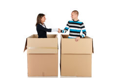 Chat box friends couple. Young couple friends in chat box, cardboard box representing chat room.  Studio, white background Royalty Free Stock Photography