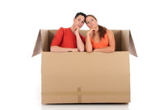 Chat box friends couple. Young couple friends in chat box, cardboard box representing chat room.  Studio, white background Royalty Free Stock Photo