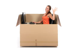 Chat box woman computer. Young attractive woman having a chat session, chat box, cardboard box representing chat room.  Studio, white background Royalty Free Stock Photography