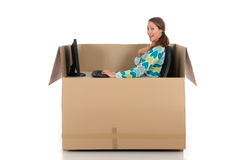 Chat box woman computer. Young attractive woman having a chat session, chat box, cardboard box representing chat room.  Studio, white background Royalty Free Stock Images