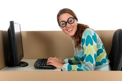 Chat box woman computer. Young nerd, geek woman having a chat session, chat box, cardboard box representing chat room.  Studio, white background Royalty Free Stock Photo