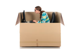 Chat box woman computer. Young nerd, geek woman having a chat session, chat box, cardboard box representing chat room.  Studio, white background Royalty Free Stock Photography
