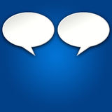 2 Chat Bubbles on Blue Background. Two blank chat bubbles talking to each other on blue background royalty free illustration