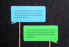 2 chat bubbles and speech balloons having discussion. Modern communication and conversation concept. Mobile and smartphone communication design made from Royalty Free Stock Photography