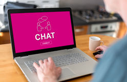 Chat concept on a laptop. Man using a laptop with chat concept on the screen Royalty Free Stock Photography