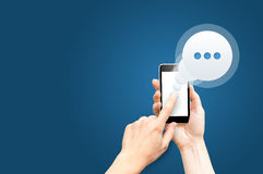 Chat. Message on smartphone screen. stock photo