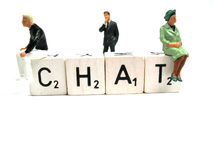 Chat and moderator. Two people on the word chat with a moderator in the middle Stock Photo