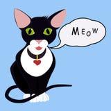 chat noir de yeux verts de bande dessinée avec le ballon de la parole Photo libre de droits