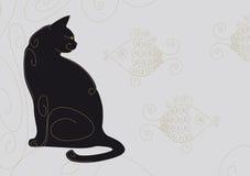 Chat noir enroulé Photos libres de droits