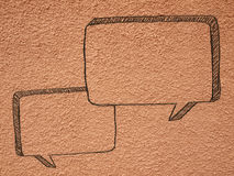 Chat paints shape form on wall Royalty Free Stock Photos