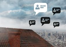 Chat profile bubbles over roof and city. Digital composite of Chat profile bubbles over roof and city stock photo