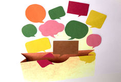 Chat symbols and opening paper bag Royalty Free Stock Images