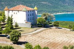 chateau in Aiguines and St Croix Lake at background, Var Departm stock photography