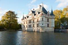Chateau Azay-le-Rideau, Loire, Frankrike på solnedgången Royaltyfri Foto