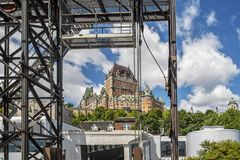Chateau Champlain as seen from Quebec ferry. Quebec cityscape and the Saint Lawrence seaway with ferry station and the Chateau Frontenac in Quebec City as a royalty free stock image