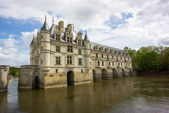 The Chateau at Chenonceau, France. Chenonceau, a chateau built on a bridge across the River Cher, France Royalty Free Stock Images
