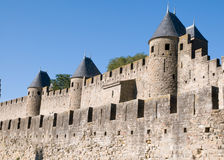 Chateau Comtal Carcassonne. The medieval walls and turrets of the Chateau Comtal in the city of Carcassonne Royalty Free Stock Images