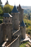 Chateau Comtal Carcassonne. The medieval walls and turrets of the Chateau Comtal in the city of Carcassonne Stock Photo