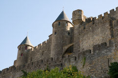 Chateau Comtal Carcassonne. The medieval walls and turrets of the Chateau Comtal in the city of Carcassonne Royalty Free Stock Photography