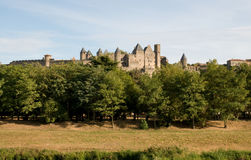 Chateau Comtal Carcassonne. The medieval walls and turrets of the Chateau Comtal in the city of Carcassonne Royalty Free Stock Photos