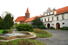 Chateau court. The renaissance chateau and the church in Pruhonice, Czech Republic royalty free stock photos