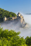 Chateau de Castelnaud in the morning mist, Dordogne. Morning mist in Chateau de Castelnaud at Castelnaud, Dordogne, Aquitaine, France royalty free stock photography