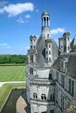 The Chateau de Chambord. Dating from the 1500s, is a well preserved  country palace in the Loire Valley, with one of its round towers and the moat visible here stock images