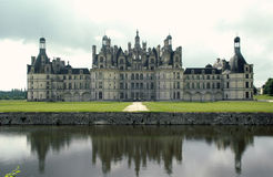 Chateau de Chambord, France. In the Loire Valley, France. Frontview of the castle with reflecting in the water stock photos