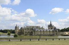 Chateau de Chantilly. Chantilly  is a commune in the Oise department in the valley of the Nonette in the Picardy region of northern France. Surrounded by Stock Photography
