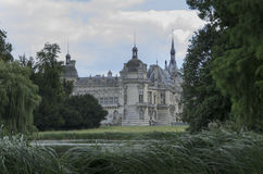 Chateau de Chantilly. Chantilly  is a commune in the Oise department in the valley of the Nonette in the Picardy region of northern France. Surrounded by Royalty Free Stock Photos