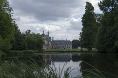 Chateau de Chantilly. Chantilly  is a commune in the Oise department in the valley of the Nonette in the Picardy region of northern France. Surrounded by Stock Photos