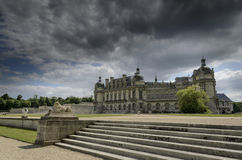 Chateau de Chantilly. Chantilly  is a commune in the Oise department in the valley of the Nonette in the Picardy region of northern France. Surrounded by Stock Image