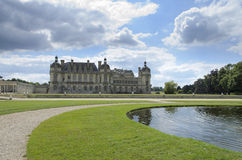Chateau de Chantilly. Chantilly  is a commune in the Oise department in the valley of the Nonette in the Picardy region of northern France. Surrounded by Stock Photo
