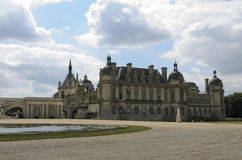 Chateau de Chantilly. Chantilly  is a commune in the Oise department in the valley of the Nonette in the Picardy region of northern France. Surrounded by Stock Images