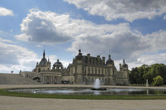 Chateau de Chantilly. Chantilly  is a commune in the Oise department in the valley of the Nonette in the Picardy region of northern France. Surrounded by Royalty Free Stock Images