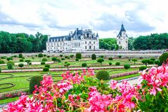 The Chateau de Chenonceau with flowers is a French chateau spanning the River Cher, near the small village of. The Chateau de Chenonceau is a French chateau royalty free stock images