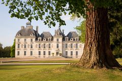 Chateau de Cheverny behind the tree. In Loire Valley, France stock photography