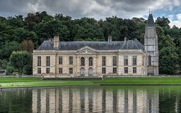 Castle of mery sur Oise with the church tower on the right and Royalty Free Stock Images