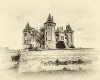 Antique Enchanted Castle. The Chateau de Saumur castle in the Loire valley of France as seen on an overcast day. This is an HDR image with an antique enchanted Stock Images