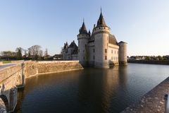 Chateau de Sully-sur-Loire, France. View From Main Street at sunset royalty free stock photo