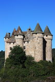 Chateau de Val. An early morning detail photo of Chateau de Val, Auvergne, France against a blue sky Stock Image