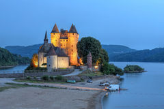 Chateau de Val, France. Chateau de Val in Auvergne, France at twilight overlooking the artificial lake surrounding it royalty free stock image