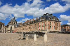 Chateau de Versailles. Under blue cloudy sky royalty free stock images